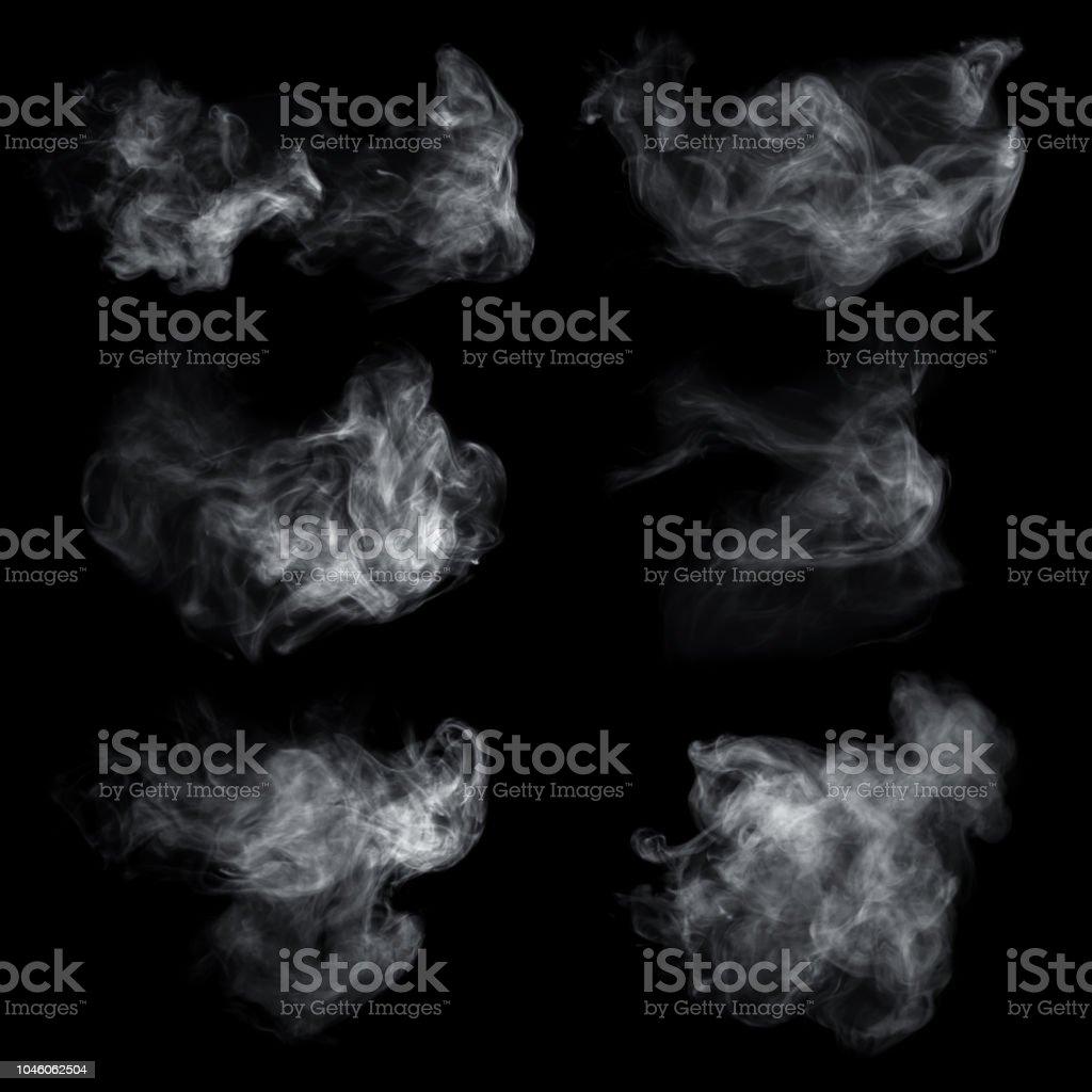 Névoa ou fumo conjunto isolado em fundo preto. Fundo branco de nebulosidade, névoa ou poluição atmosférica. foto de stock royalty-free