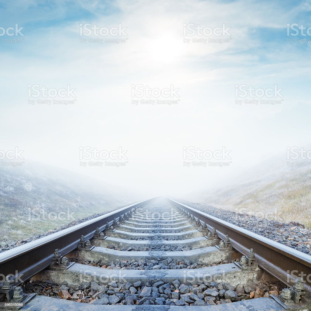 fog over railroad and clouds with sun over it Lizenzfreies stock-foto