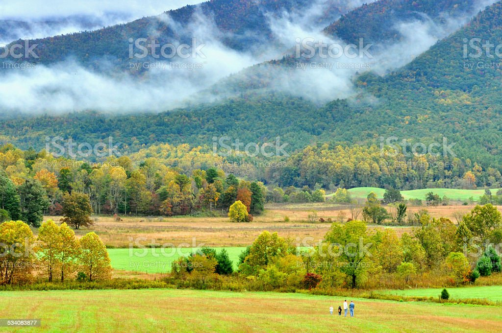 Fog over the fields of Cades Cove. stock photo
