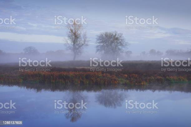 Photo of Fog over the lake in early morning