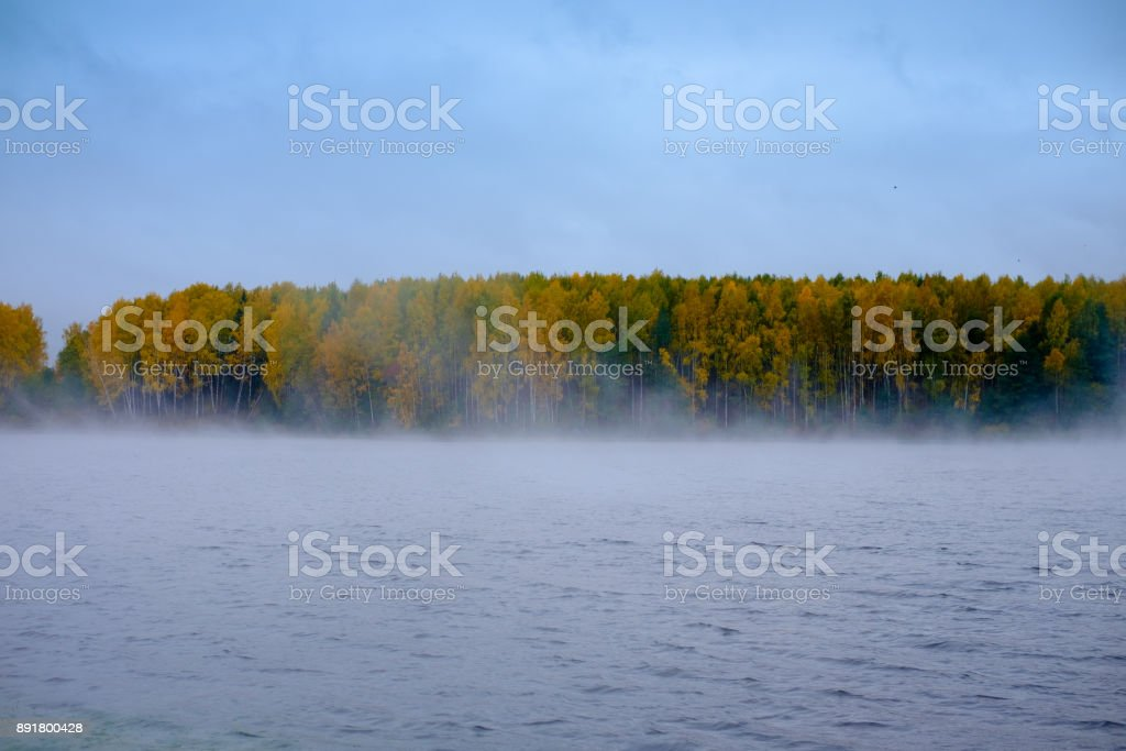 Fog over the river early in the morning stock photo