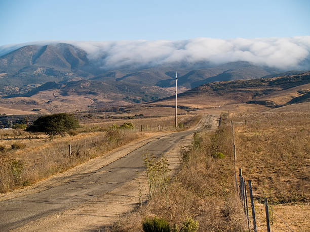 fog rolling down cuesta grade - central coast california stock photos and pictures
