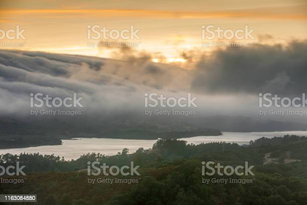 Photo of Fog Rolling over Crystal Springs Reservoir as seen from a vista point off Highway 280 on a Summer Sunset.