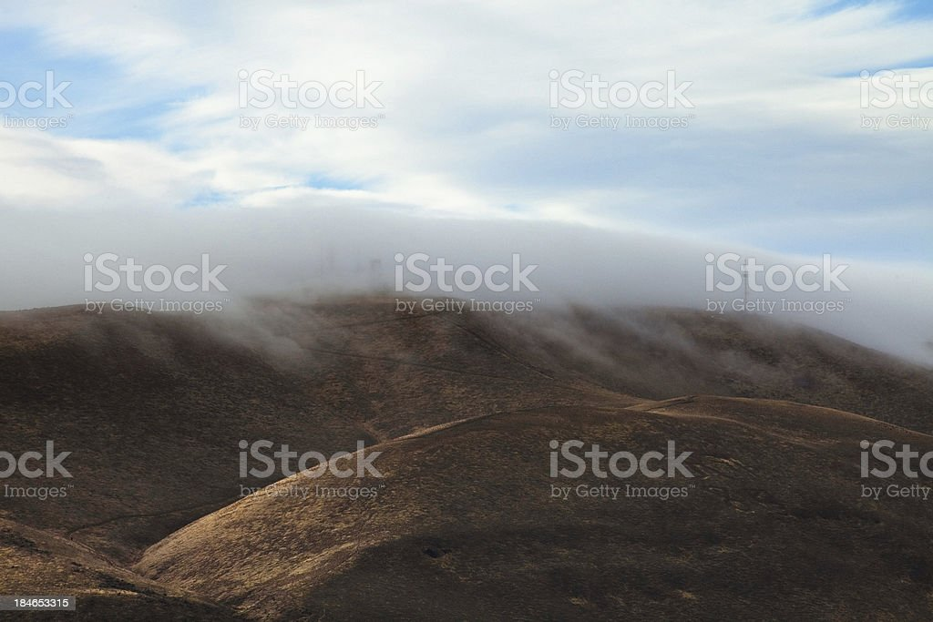 Fog Rolling Over Hill stock photo