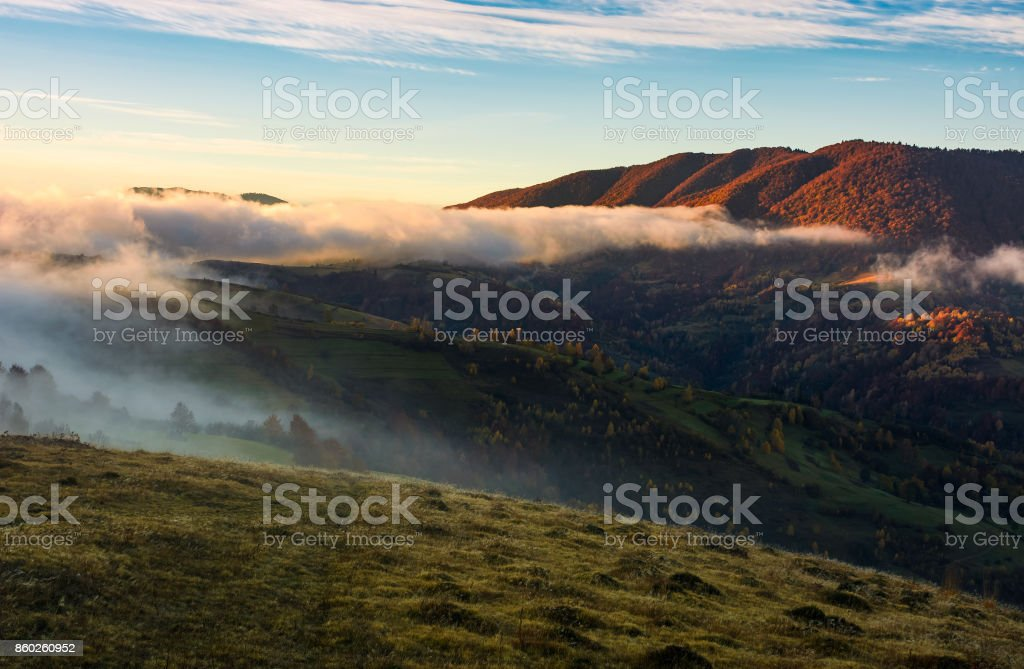 fog rolling over the hills at sunrise stock photo