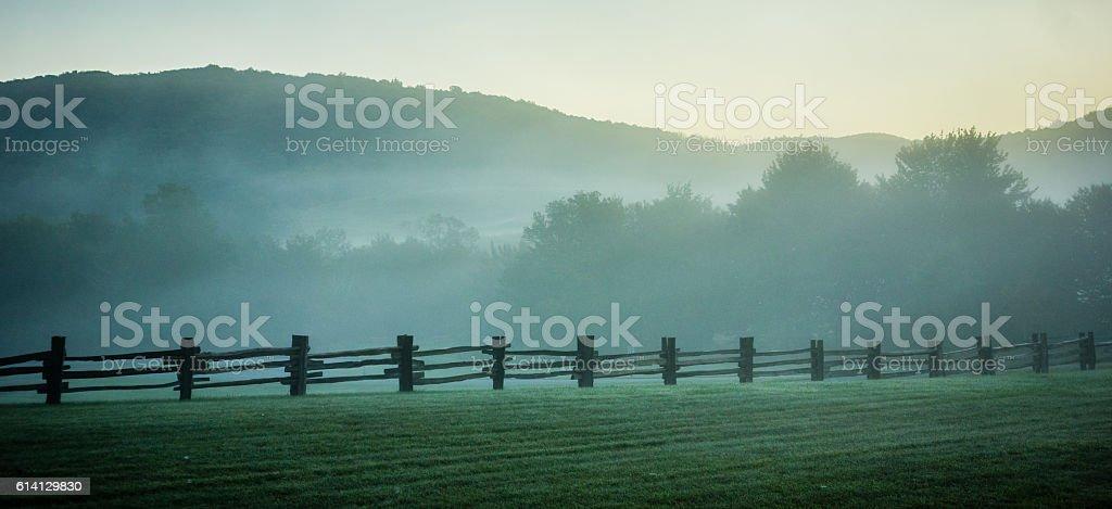 fog rolling through blue ridge parkway farm lands stock photo