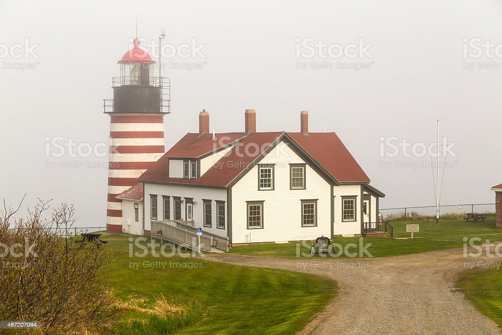 Fog Shrouded Lighthouse stock photo