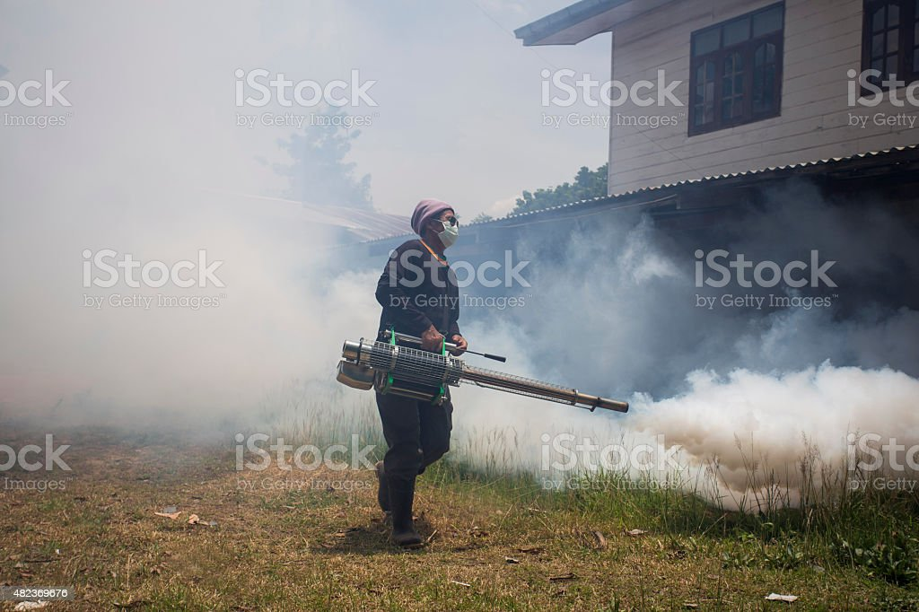 Fogging to prevent spread of dengue fever stock photo