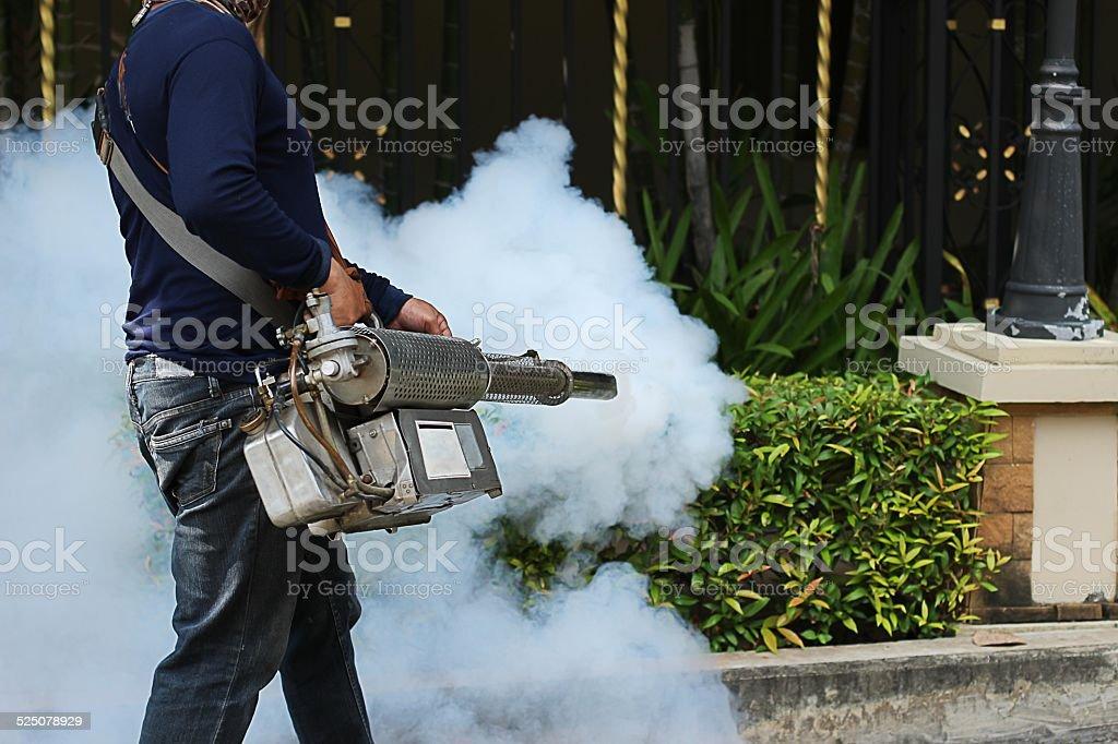 Fogging to prevent the dengue fever stock photo