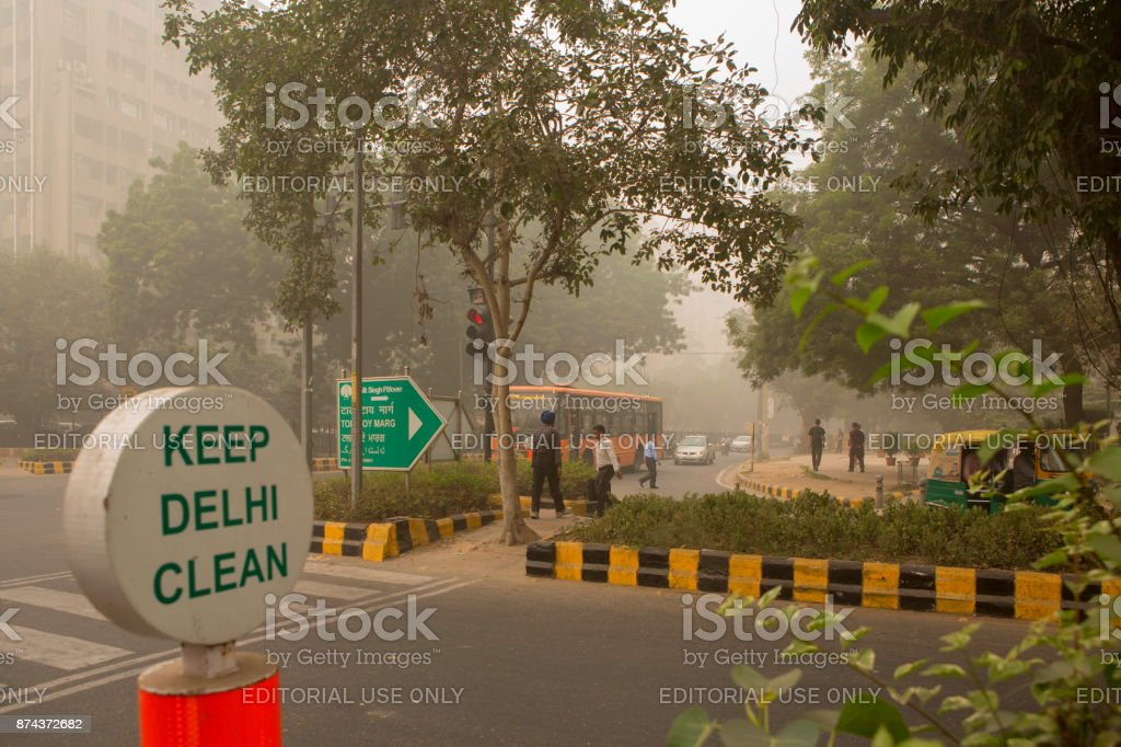 Foggy afternoon street view of New Dehi stock photo