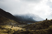 View of misty mountains and picturesque valley in Chilean Patagonia