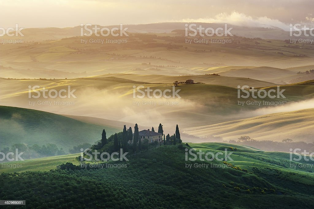 Foggy and sunny morning in Tuscany royalty-free stock photo