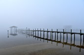 Foggy bay inlet with pier