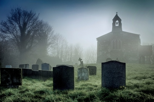 Foggy churchyard on the Lincolnshire Wolds