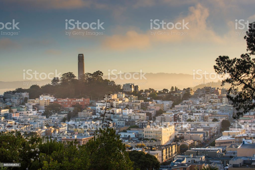 Foggy cityscape overview of Coit Tower in San Francisco stock photo