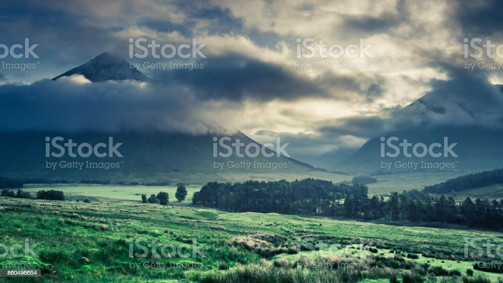 Foggy dawn over the mountains of Glencoe, Scotland stock photo