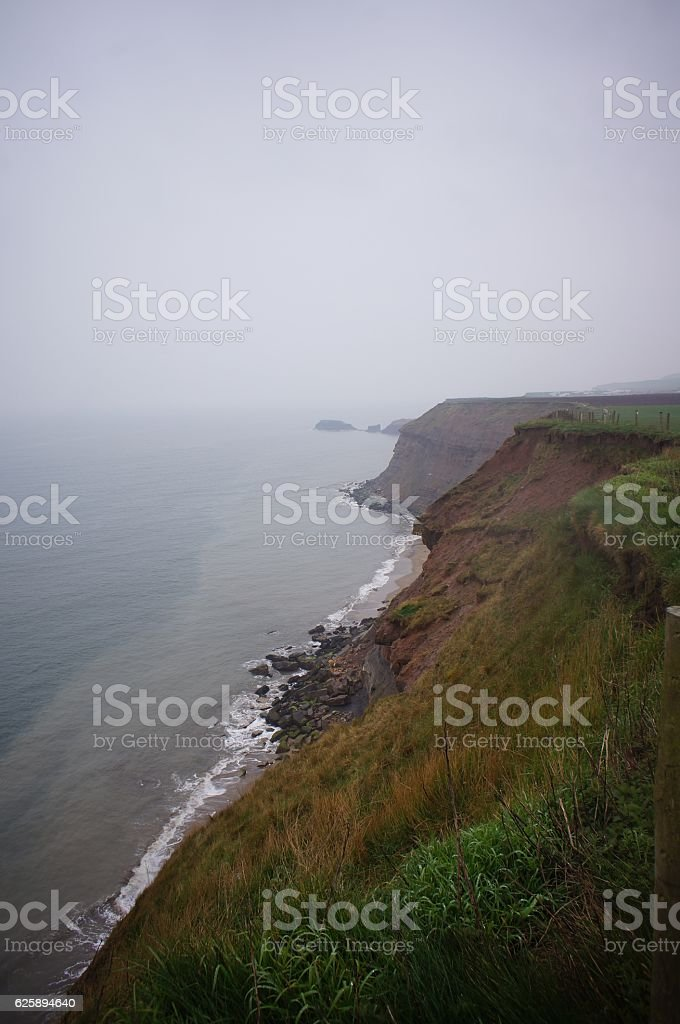Foggy day at the cliff and the sea stock photo