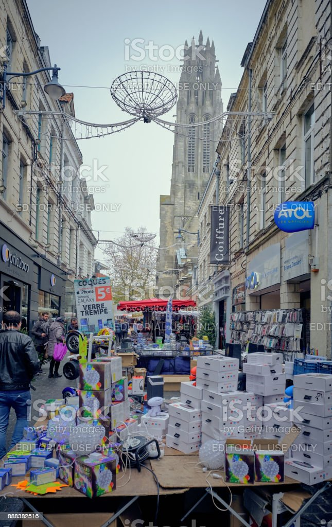 Foggy day of December in Arras, France. Some people do some shopping. stock photo