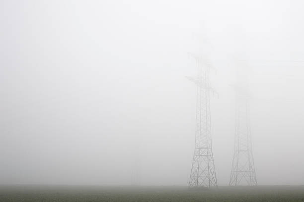Foggy Electricity Pylons stock photo