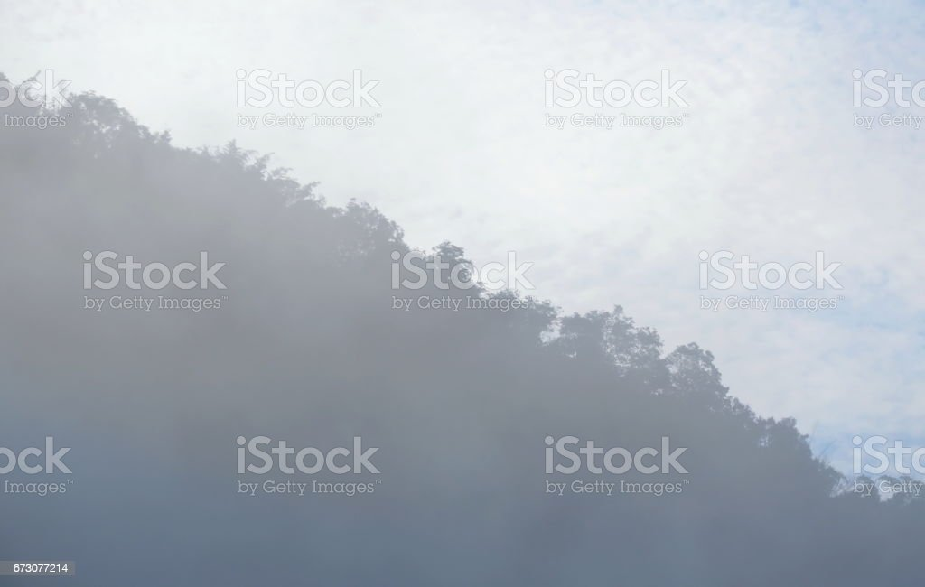 foggy floating and cover mountain slope stock photo