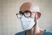 Foggy glasses by wearing face mask (Coronavirus epidemic problem).