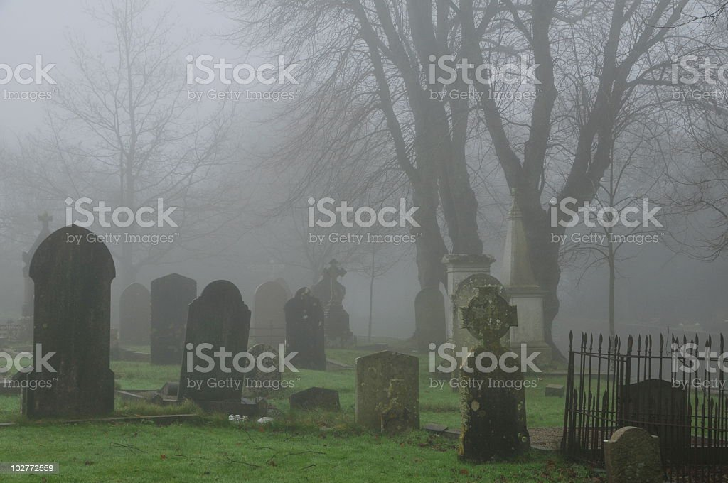 Foggy graveyard,Jersey. stock photo