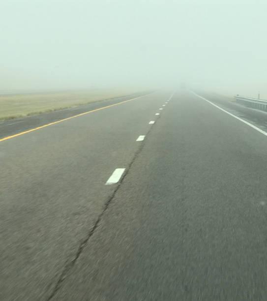 Foggy highway drive stock photo