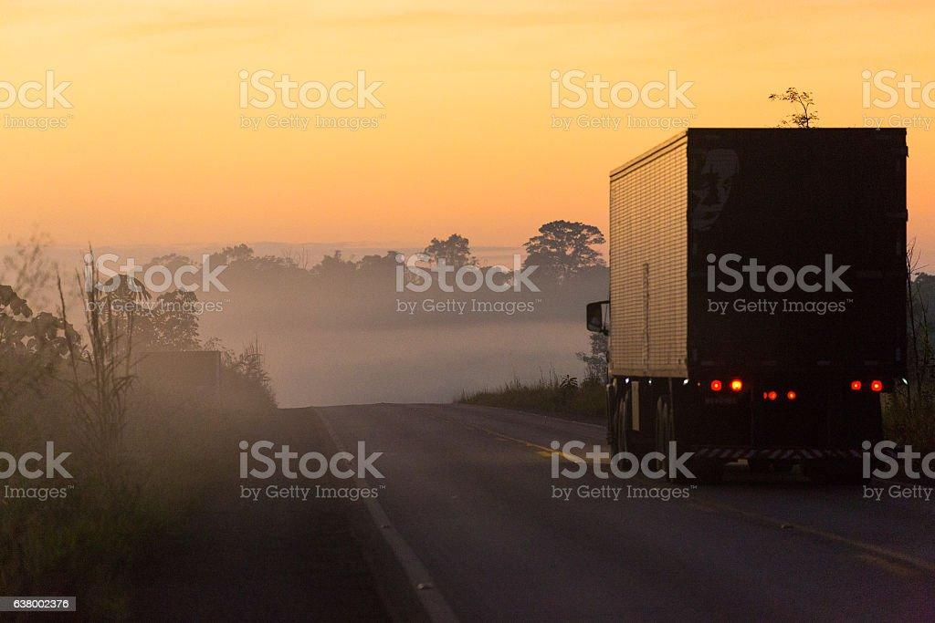 Foggy Landscape, Truck on Road during Sunrise, Amazon, Rondônia, Brazil stock photo