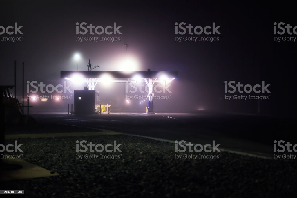 Foggy Midnight Gas Station Canopy Interstate Expressway Rest Stop Lights stock photo
