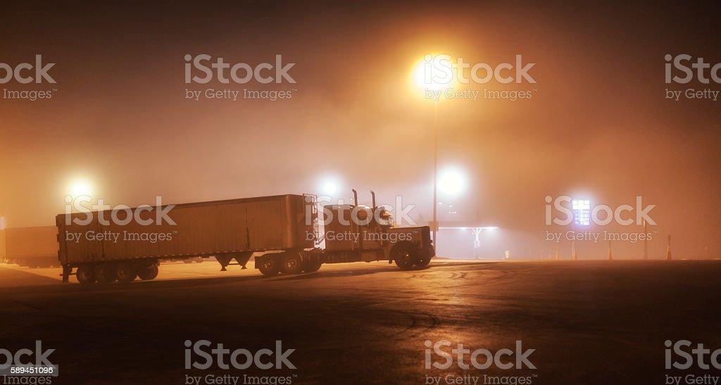 Foggy Midnight Interstate Expressway Rest Stop Parked Semi Trailer Truck stock photo