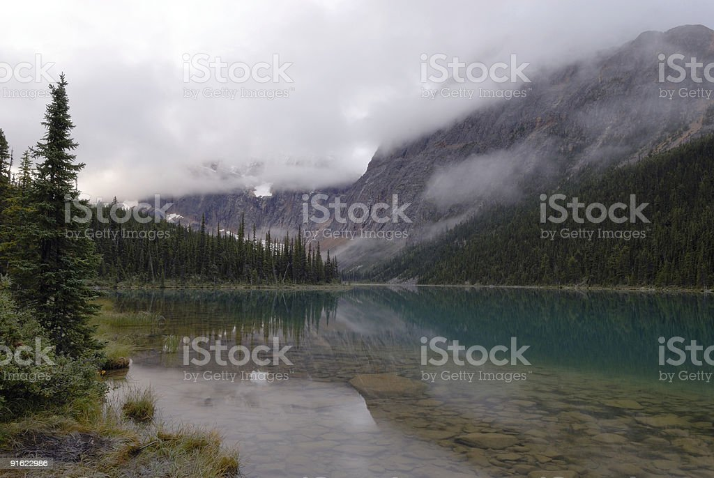 Foggy morning at Cavell Lake in Canadian Rockies royalty-free stock photo