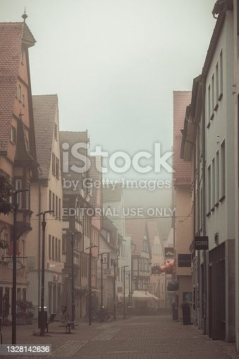 istock Foggy morning in the Hafengasse in Ulm, Germany 1328142636