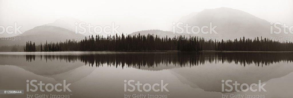 Foggy mountain lake stock photo