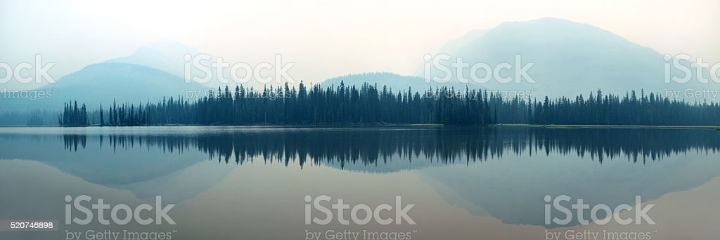 Foggy mountain lake stock photo