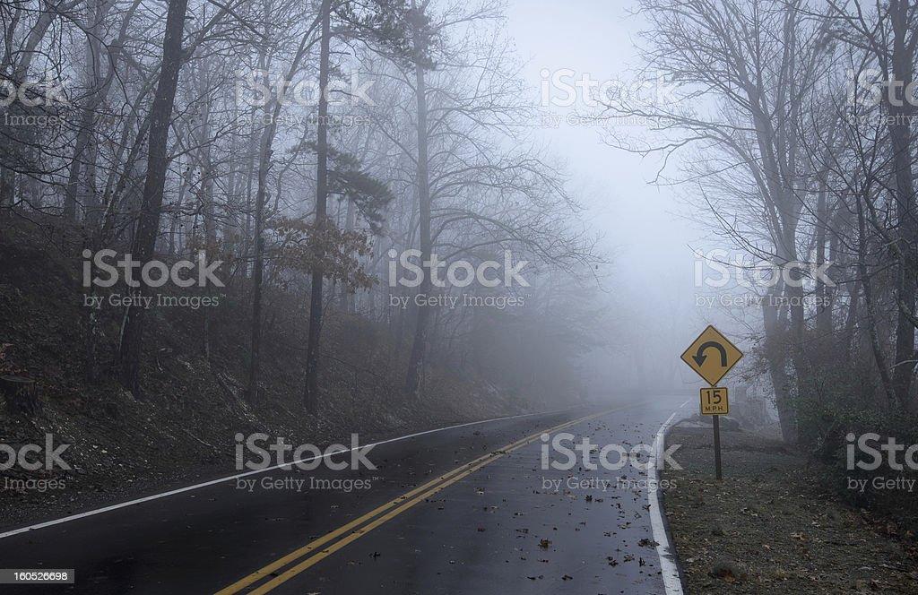 Foggy mountain road royalty-free stock photo