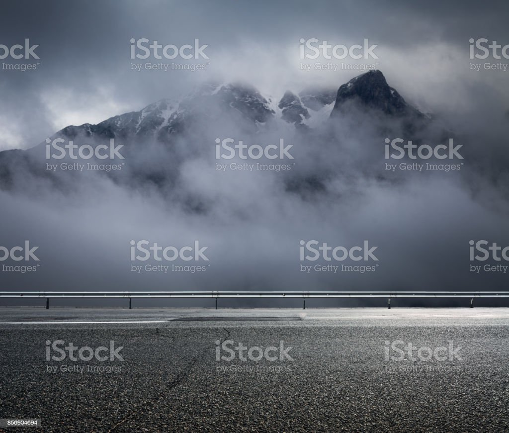Foggy mountains and asphalt road stock photo
