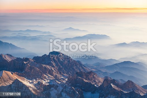 istock Foggy mountains at sunset 1137681109