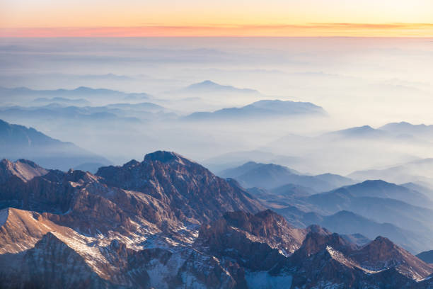 Foggy mountains at sunset stock photo