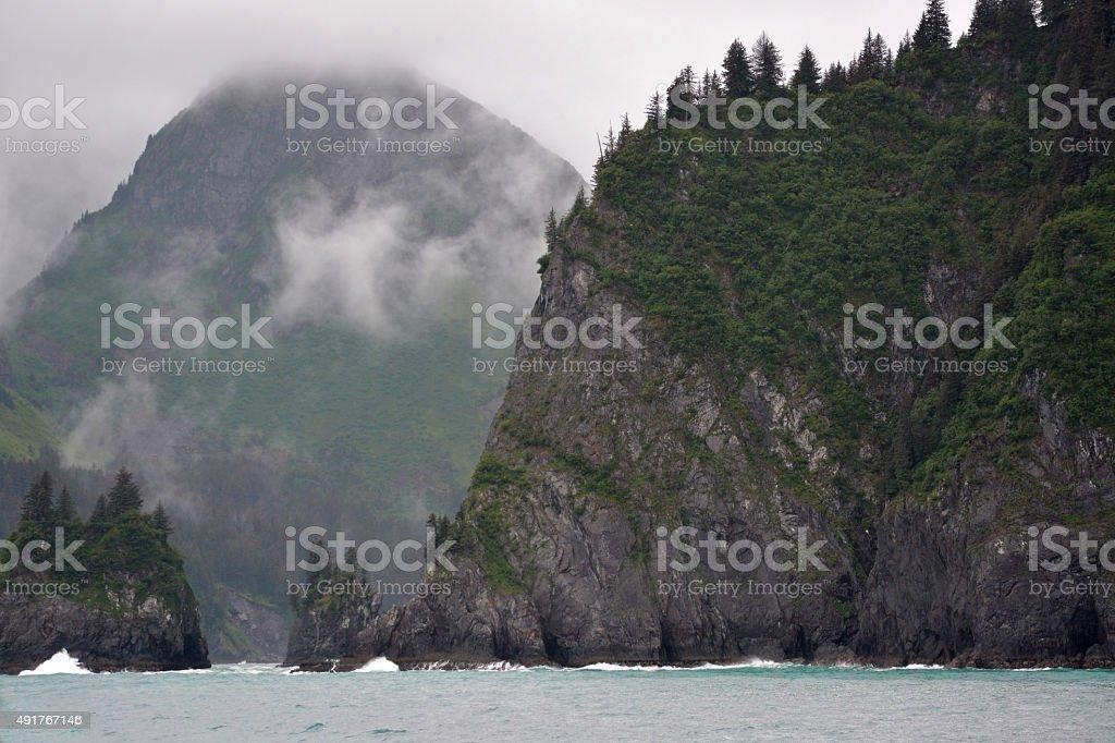 Foggy Mountains on the Coast of Seward, AK stock photo