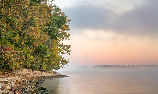 istock foggy over a river or lake 1083081798
