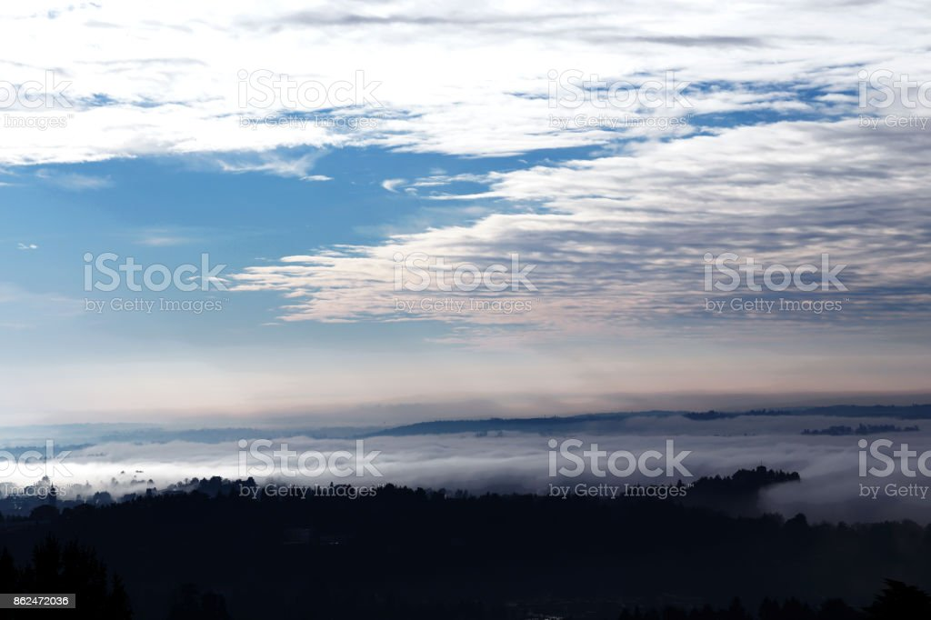 Foggy panorama view from Sacro Monte, Varese is a town in the north of Italy stock photo