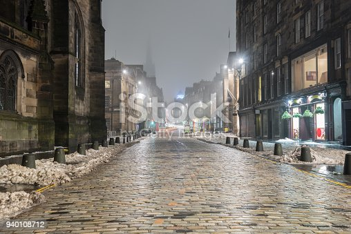 Photo of a Deserted Stretch of the Royal Mile in Old Town Edinburgh on a Cold Foggy Winter Night
