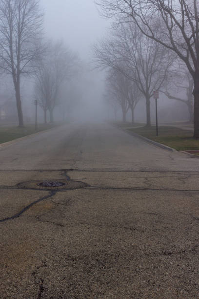 Foggy Suburban Road Foggy Suburban Road kathrynsk stock pictures, royalty-free photos & images