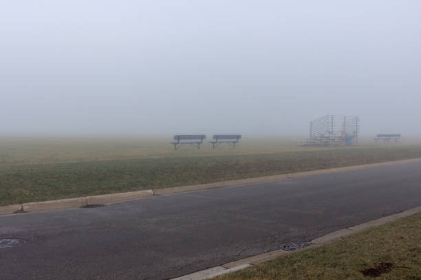 Foggy suburban soccer field Foggy suburban soccer field kathrynsk stock pictures, royalty-free photos & images