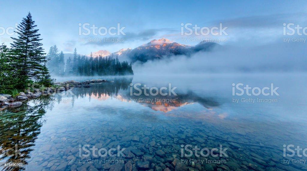 Foggy Sunrise at Pyramid Lake in Jasper, Alberta, Canada stock photo