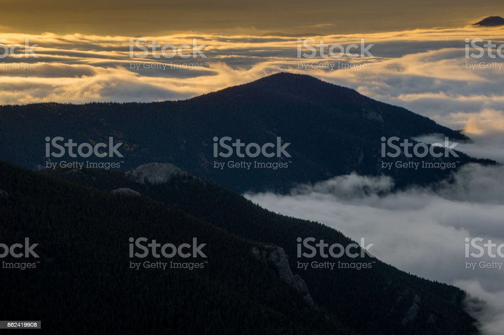 Foggy Sunrise in the Rocky Mountains stock photo