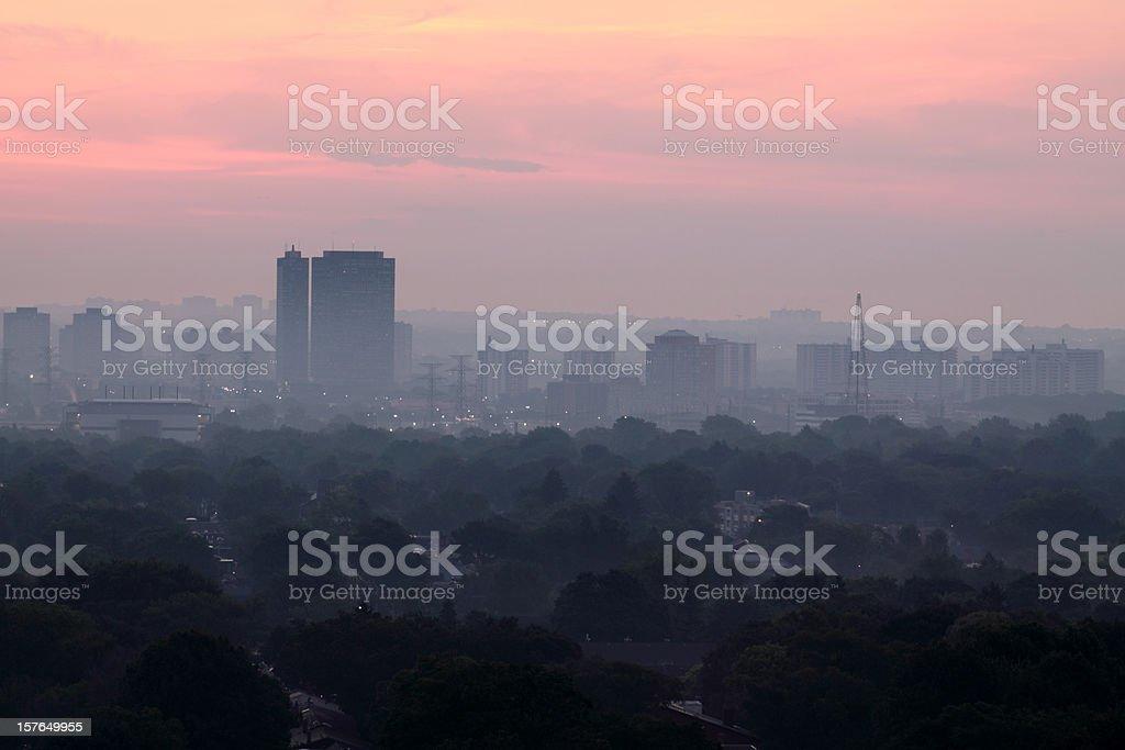 Foggy sunrise over city royalty-free stock photo