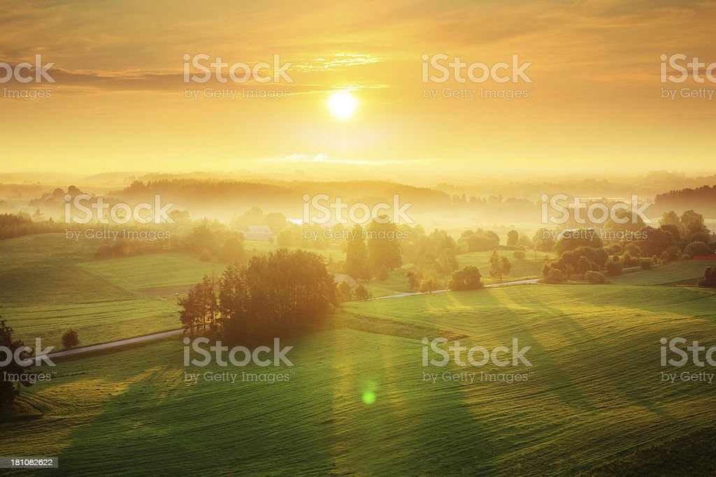 Foggy Sunrise over the Farmland Landscape - Rolling Hills stock photo