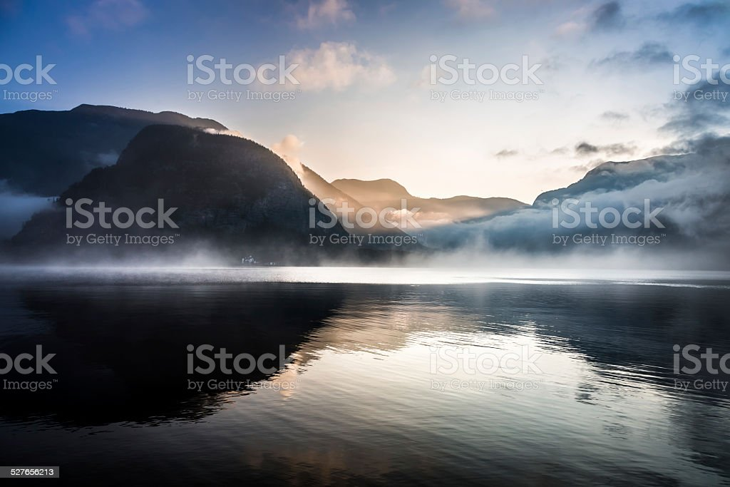 Foggy sunrise over the mountains stock photo