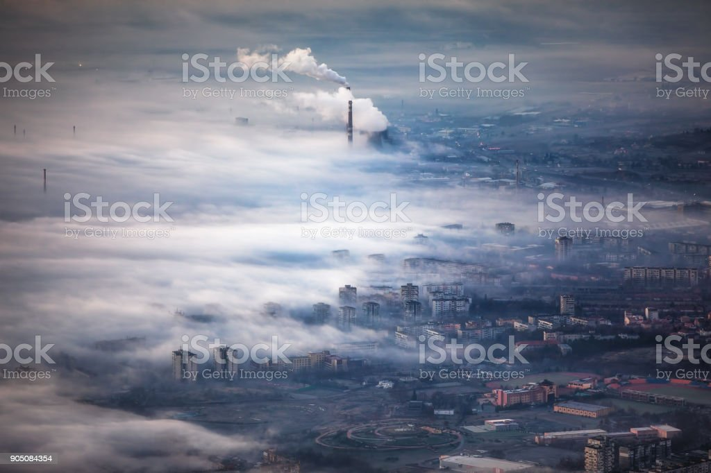 Foggy Sunrise view over the city from above, aerial view stock photo